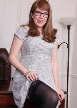 Hairy secretary Bebe Fuller strips butt naked in her office chair. in Karupsow | Elite Mature