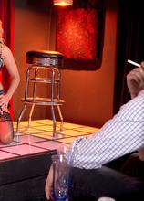Busty MILF stripper Amber Lynn offers extras
