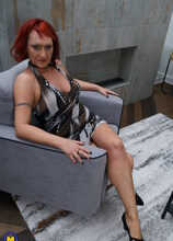 Naughty housewife playing with her shaved pussy