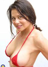 This naughty MILF starts masturbating on her balcony