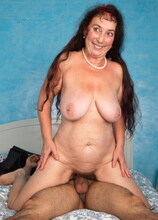 This curvy hairy mature lady loves having sex with a younger guy