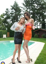 One hot babe doing a naughty lesbian mom in the garden at the pool