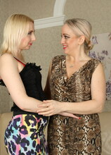 Naughty lesbian housewives playing on the couch