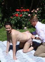 Big breasted Eva Jayne having fun in the garden
