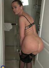 Naughty housewife taking a hot and steamy shower