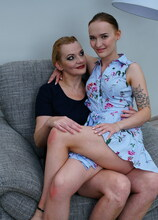 Two naughty old and young lesbians playing in bed