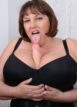 Huge breasted Carol Brown loves to show off her naughty side