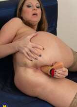 Naughty housewife grinding on her couch
