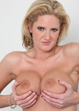 Busty mature babe Zoe Zale sucking on her toes.