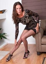 Older MILF Sofie Marie pulls down her pantyhose.