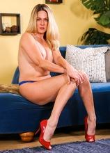 Blonde MILF Angela Attison naked in her red heels.