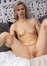 Blonde MILF Midge Mayor gets turned on by her dirty mags. in Karupsow | Elite Mature