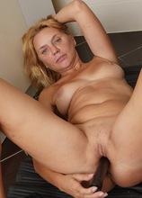 Amateur MILF Alla Peek toys her older pussy in the locker room. in Karupsow | Elite Mature
