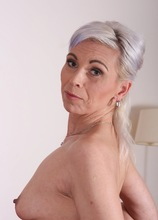 Grey haired mature babe Kathy White plays with her pussy.