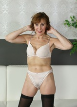 Mature redhead Amy D posing naked in only her black stockings. in Karupsow   Elite Mature