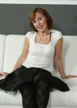 Older mature amateur Amy D naked in only black stockings.