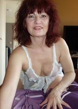 Older mature redhead Wanda stuffs pussy with big toy.