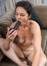 Mature babe Anette Harper toys pussy after a glass of wine.