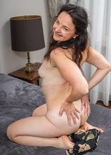 Brunette MILF Anette Harper masturbates after watching porn.