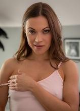 Brunette MILF Alyssa Reece spreads her trimmed pussy lips.