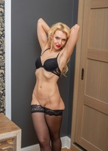 Stunning MILF Milena naked in only her black stockings.