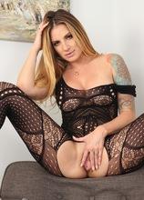 Tattooed busty MILF Teagan Presley toys her wet pussy.