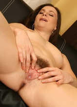 Hairy mature babe Jessica fingers her very tight pussy!