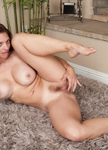 Horny MILF Mindi Mink rubbing her trimmed hairy pussy.