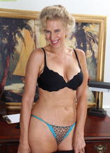 Blond cougar Cally Jo spreads her hairy pussy on the desk.