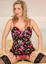 Blonde MILF Britney fondles big natural tits before masturbating.