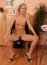 Business woman Janet Darling strips naked at her desk.