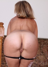 Mature blond babe Sky pulls panties down over tan lined ass.