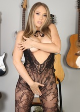 Busty MILF Kagney Lynn Karter in crotchless black stockings.