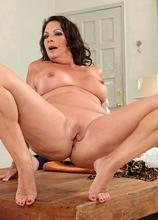 Older office babe Margo Sullivan toys pussy after work.