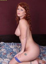 Mature redhead Sara Orlando toys her juicy pussy.