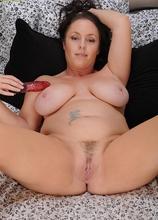 Mature amateur Tamara Fox squeeze big natural tits together.