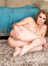 Thick mature amateur Cristine Ruby strips butt naked.
