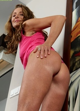 Michelle Gaia gives closeup of her shaved mature pussy.