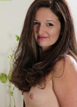 Gorgeous wife Stephanie Roberts spreads her wet pussy lips.