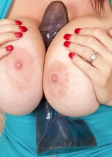 Very busty MILF Charlee Chase bounces on her sex toy.