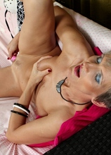 Horny older babe Melanie toys her hungry mature twat.