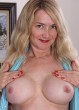 Busty cougar Eva Griffin spreads her older pussy.