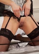 Stunning MILF Miah Croft wearing only black stockings.