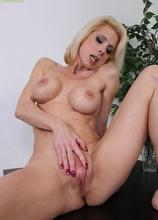 Horny older blond Jodie Stacks grinding on pink toy.