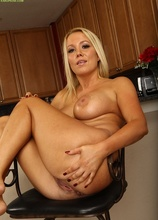 Busty cougar Tara Star rubs her pussy on the counter.