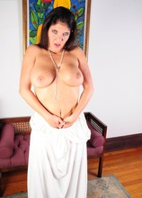 Busty cougar Coralyn Jewel gets naked and sucks on her toes.