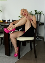 Horny wife Tina fingers pussy wearing only pink heels.