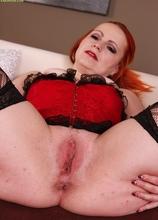 Mature redhead Svitokova finger blasts her older pussy.