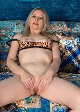 Older blonde babe Emma Turner spreads her shaved twat.