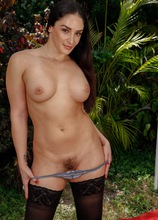 Busty MILF Sheena Ryder exposes her hairy pussy in the backyard.